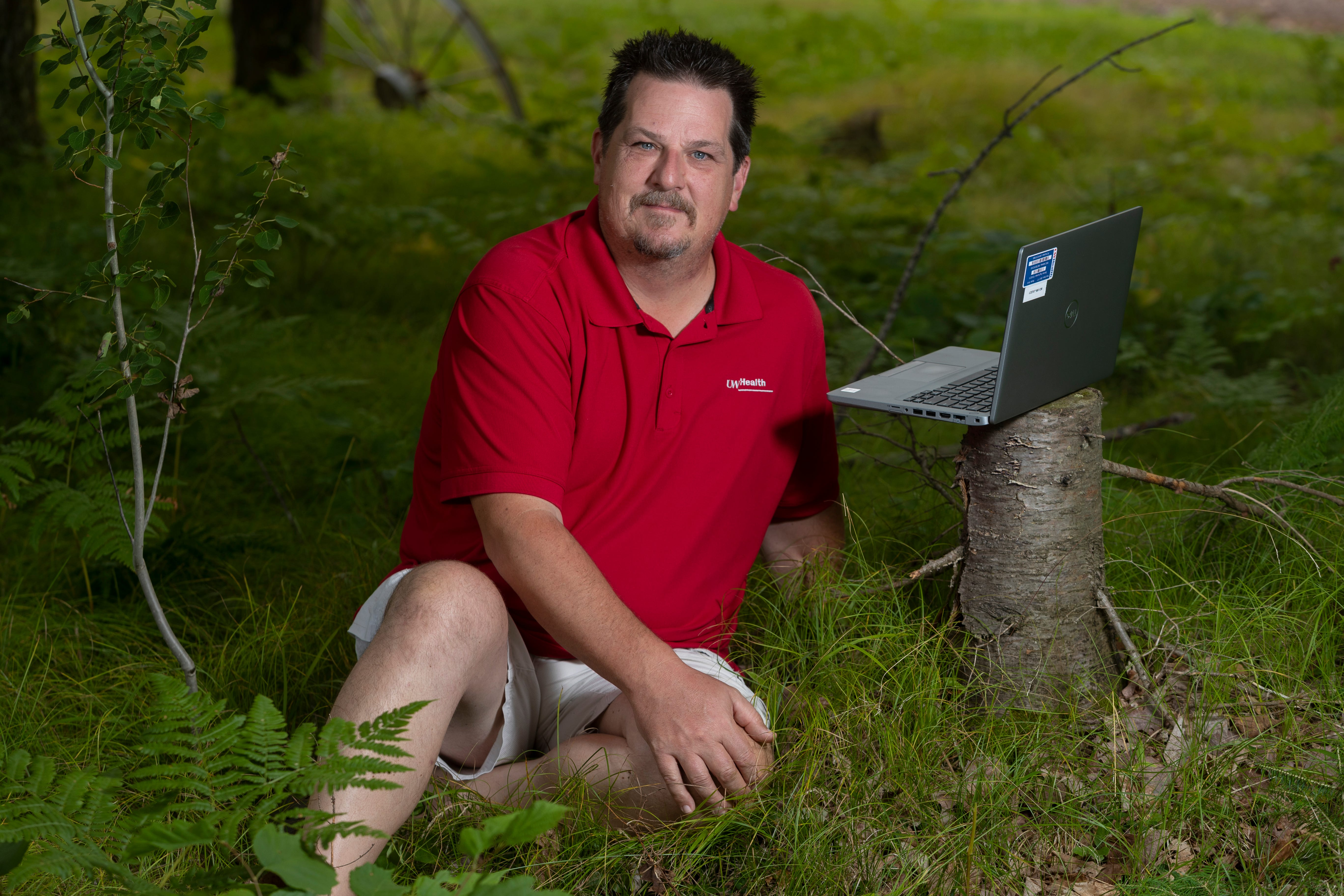 Jeff Ulrich is a regional program manager for UW Health who works from his home despite having slow internet on his 40-acre property.