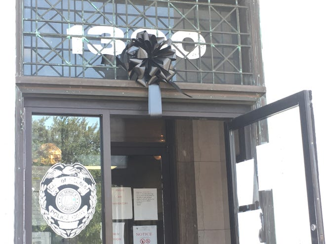 A black wreath hangs over the public entrance of the Selma Police Department building in downtown Selma.