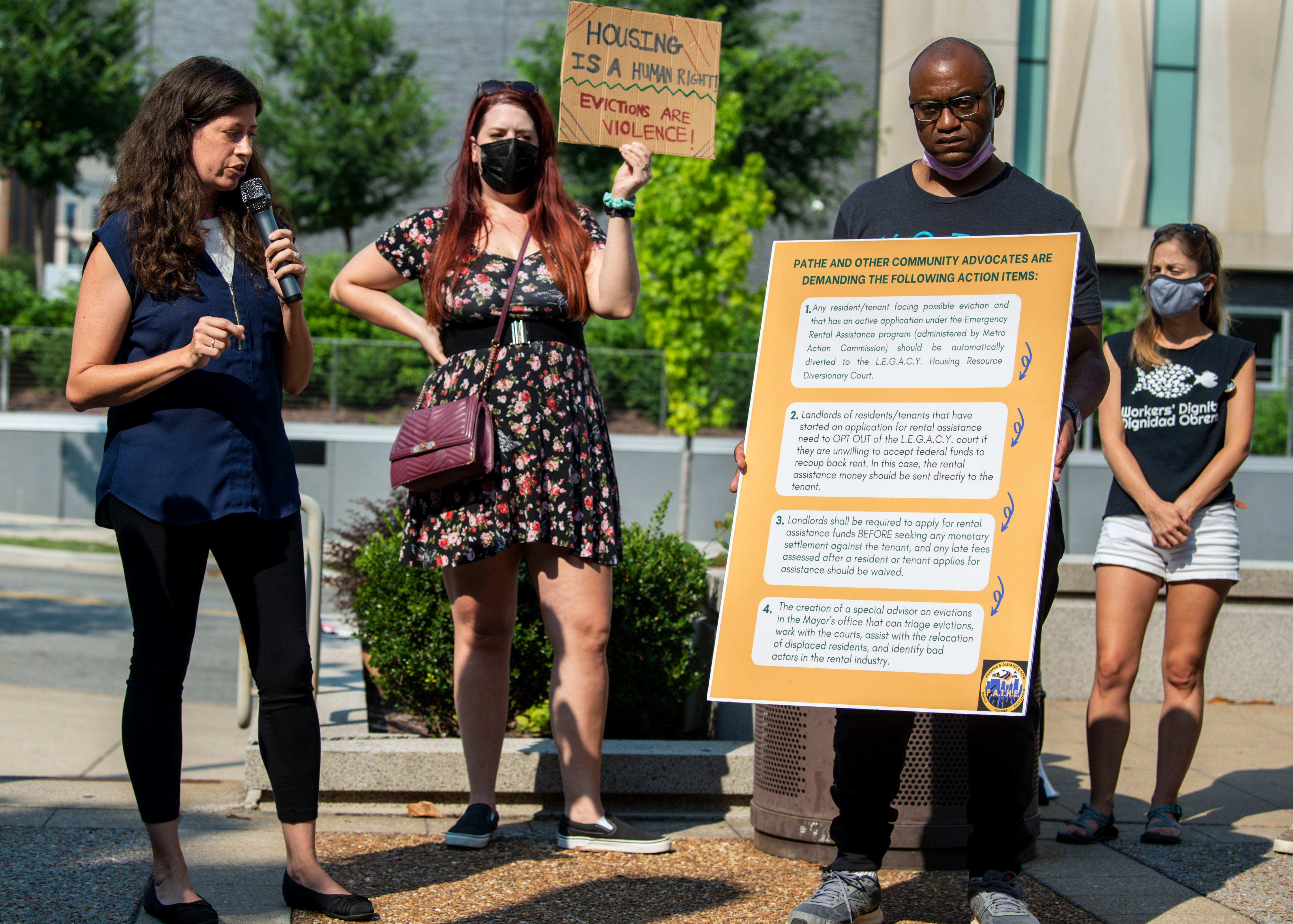 Melissa Cherry reads the action items made by PATHE and other community advocates for  during a press conference held by People's Alliance for Transit, Housing and Employment outside the Justice A. A. Birch Building in Nashville, Tenn., on Wednesday, July 28, 2021.