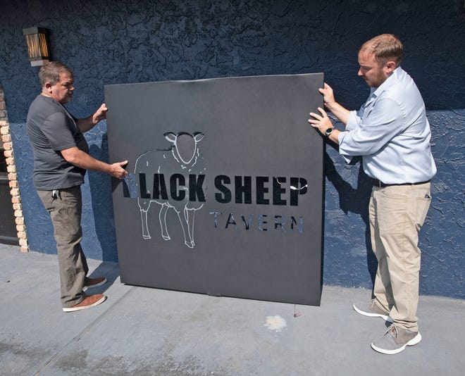 Black Sheep Tavern Executive Chef John Smith, left, and owner Simon Courtney look for the perfect location of the new restaurant's outdoor sign Wednesday. Courtney is looking to bring a unique dining and bar experience to the East Pensacola Heights area in early September.