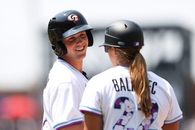 Adley Rutschman, left, of the American League, talks with Rachel Balkovec during the third inning of the MLB All Star Futures baseball game, Sunday, July 11, 2021, in Denver. (AP Photo/Gabe Christus)