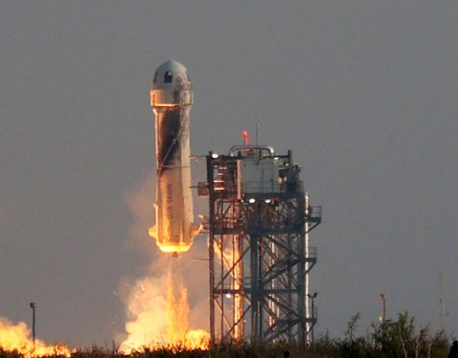 Blue Origin's New Shepard lifts off from the launchpad carrying Jeff Bezos and others on July 20, 2021, in Van Horn, Texas. (Joe Raedle/Getty Images/TNS)