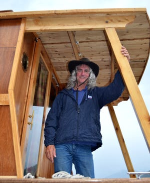 Boat-builder Kerry Elwood at 2014 launch party at Detroit Lake for the hand-crafted Water Woody houseboat.