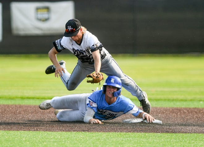 Sioux Falls East's Grant Graber leaps over Renner's Austin Henry as he slides to second base in the American Legion state baseball championship on Tuesday, July 27, 2021 at Aspen Park in Brandon.