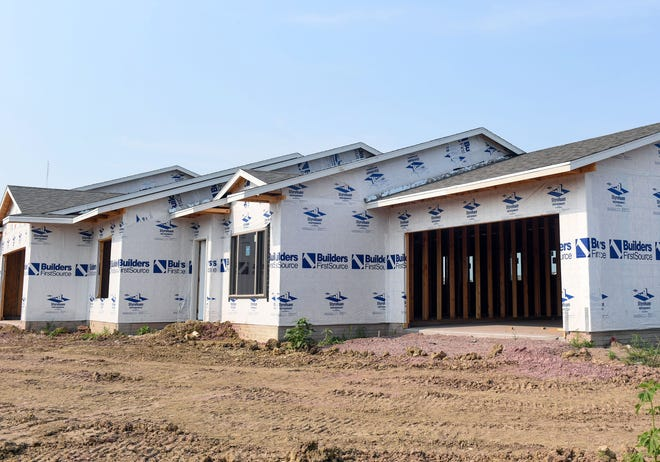 Construction continues on a series of apartments on Wednesday, July 28, 2021 on Vineyard Avenue in southeastern Sioux Falls.