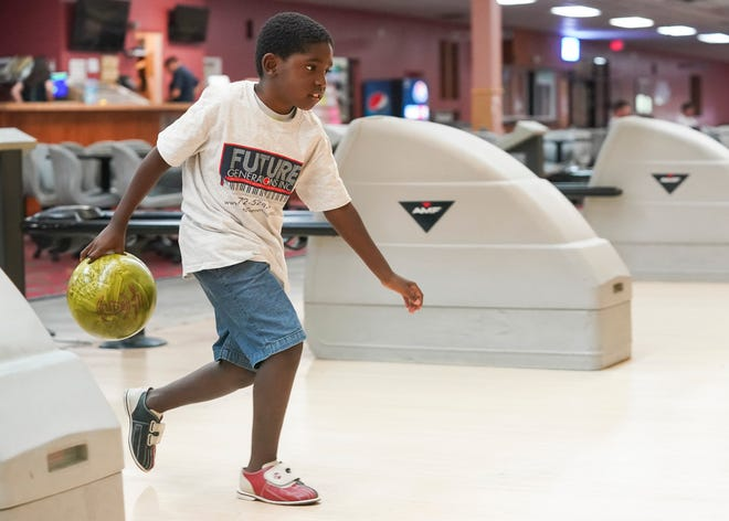 Jermaine Lewis, 7, makes his way to send his ball down the lane while bowling with the Future Generations summer camp on Wednesday, July 28, 2021, at Lucie Lanes in Port St. Lucie. Kids can bowl for free this summer at participating bowling alleys nationwide, including Stuart Bowl, Vero Bowl, Lucie Lanes and Superplay USA, both in Port St. Lucie. Age requirements vary by location, but kids can register for two free games every day until the end of August at KidsBowlFree.com.