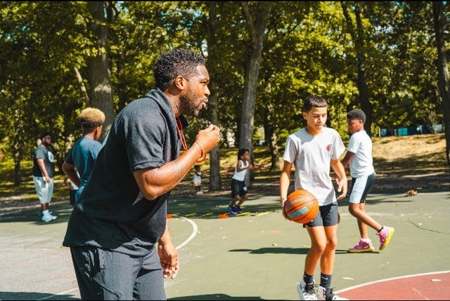 Anthony Farmer, left, works with kids during a recent basketball camp. He'll be a part of a free basketball camp at Vineland's Magnolia Park on Saturday.