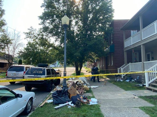 Police investigate a shooting outside a home on Orchard Street early Wednesday morning.