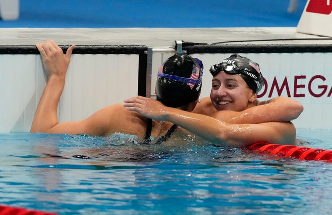 Alex Walsh (USA) and Kate Douglass (USA) celebrate after placing second and third in the women's 200m individual medley final.