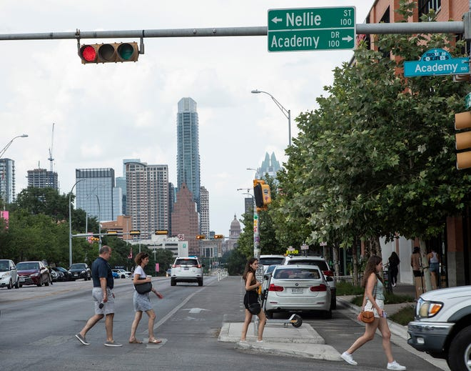 Pedestrians cross the street at South Congress Avenue and Nellie Street, a potential spot for an Orange Line tunnel to emerge south of Lady Bird Lake. Austin Transit Partnership is considering plans for a tunnel under the lake.
