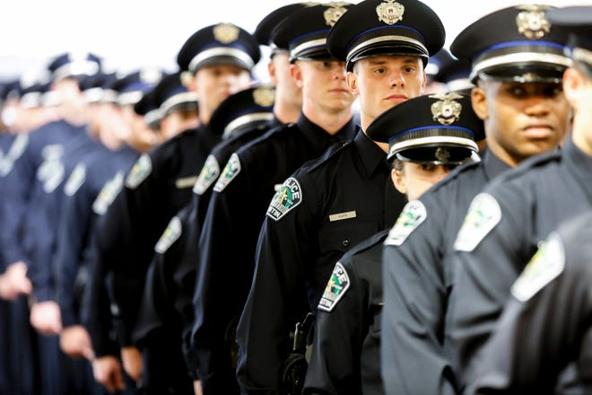 Austin Police cadets participate in a commencement exercise for the 140th cadet class of the Austin Police Training Academy in May 2019. [JAMES GREGG/AMERICAN-STATESMAN]