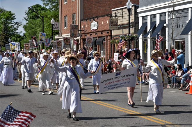 Members of the League of Women Voters of Hudson march through downtown Hudson in the city's Memorial Day parade in honor of 100th anniversary of women getting the vote. The Hudson organization will mentor a new Twinsburg group that is forming.