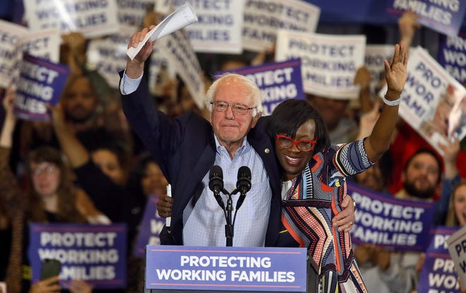 U.S. Sen. Bernie Sanders, D-Vermont, and former Ohio Sen.  Nina Turner acknowledge the crowd as Sen. Sanders arrives at a Protecting Working Families tour stop in 2017 at the John S. Knight Center in Akron.  (Mike Cardew/Beacon Journal/Ohio.com)