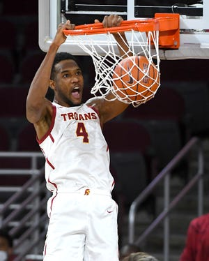 Feb 22, 2021; Los Angeles, California, USA; Evan Mobley (4) dunks the ball in the second half of the game against the Oregon Ducks at Galen Center.