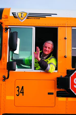 Albin Weiler waves from his bus. Weiler, a bus driver for the Nordonia Hills Schools for about 17 years, wrote a book about his experiences driving a bus.