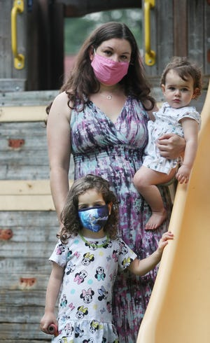 Shannon Kerns, with daughters Olivia, 1, and Veronica, 4, is pushing the Copley-Fairlawn district to have all students wear masks. Veronica, who would be going into preschool, has a physical disability and is more vulnerable to COVID-19.