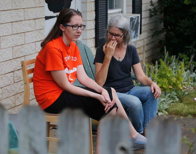 Grace Hanson, 31, left, and her mother, Carolyn Hanson, who is holding back tears, talk Thursday about Grace being forced to find another place to live as they sit outside Grace's apartment at Stow-Glen Retirement Village through Pathway to Independence.