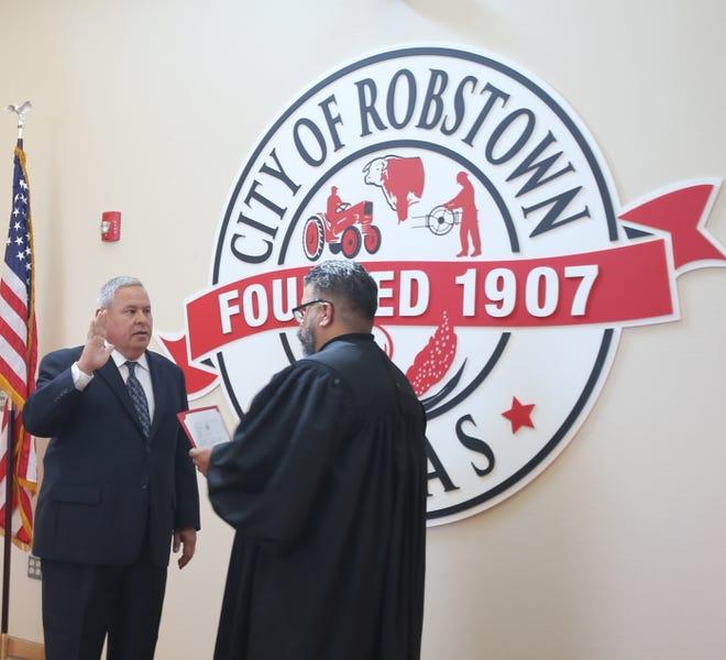 Rex Ramon is sworn in as Robstown's new Police Chief by Judge Antonio Gonzalez.
