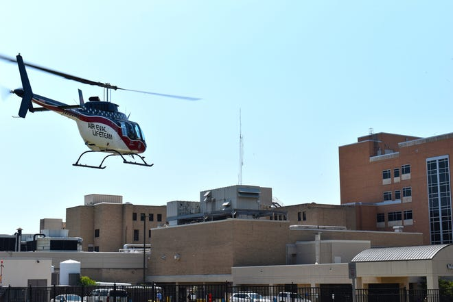 A helicopter prepares to land at Mercy Hospital Ardmore Thursday, July 8, 2021. Climbing rates of COVID-19 infections locally and nationwide are putting another strain on hospitals and making transfers in and out of Ardmore's hospital more difficult.