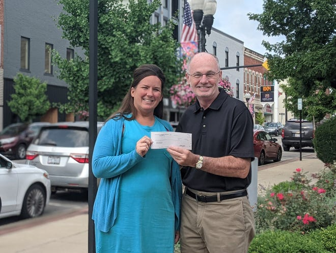 Ashland County Community Foundation President/CEO Jim Cutright presents a check from an anonymous donor family's donor