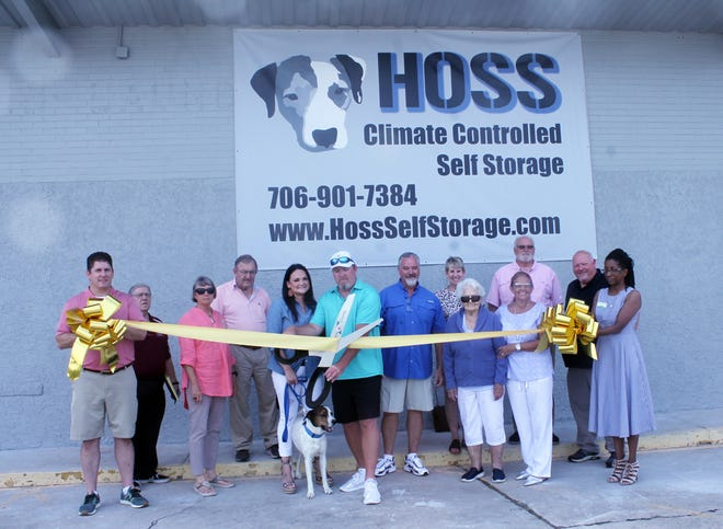 Justin Mooney cuts the ribbon on Hoss Climate Controlled Self Storage in Louisville.