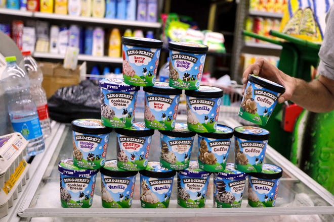 A man buys Ben & Jerry's ice cream in Jerusalem on July 20, 2021. (Ahmad Gharabli/AFP via Getty Images/TNS)