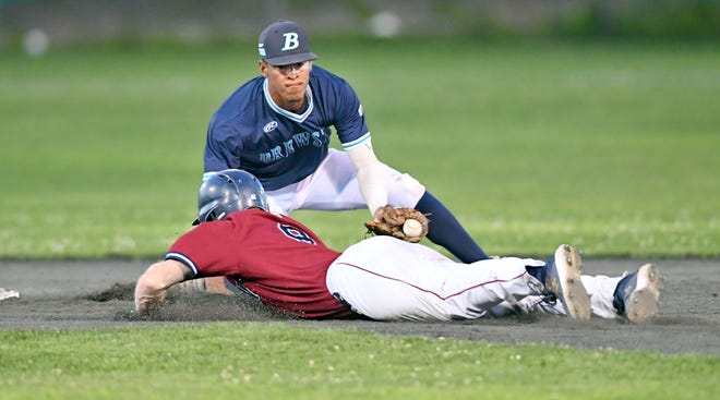 Jack Brannigan of Wareham dives into the tag of  Brewster shortstop Trey Faltine in Brewster's 5-3 win on Wednesday.