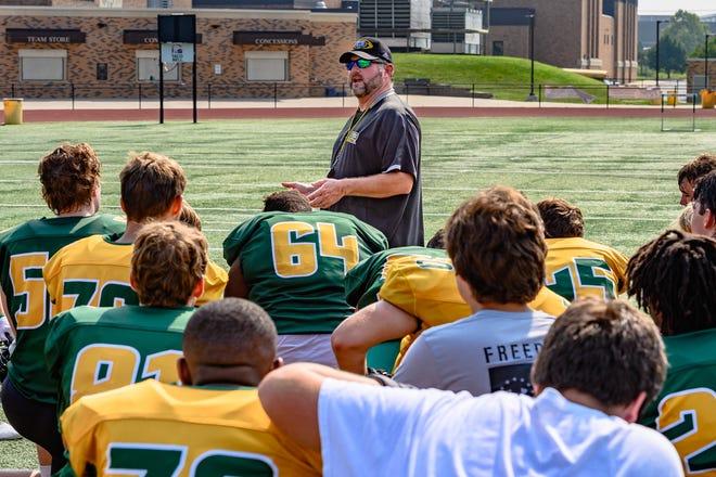 Rock Bridge head coach Van Vanatta talks to his team after wrapping up practice on July 22 in Columbia.