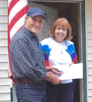 Friendship House volunteer Lucinda Loomis was presented with the Bronze President's Volunteer Service Award by Ron Milton, Friendship House Board Member.