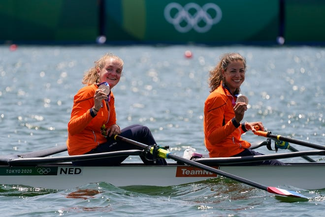 Former Buckeye Ilse Paulis (on right) has won medals in two straight Olympics.
