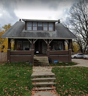 The home at 1487 Kenmore Road was boarded up Thursday after the city took action against the property that officials say has long been the site of alleged drug activity and gun violence.