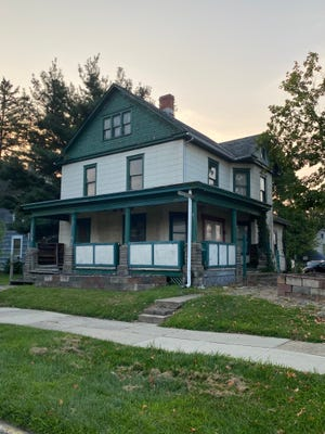 This house at 32 W. College Ave. is being considered for demolition to build a new three-story, mixed-use building with retail on the first floor and apartments on the second and third floors.