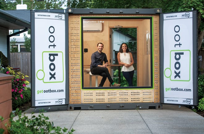 Robbie Friedman and Allison Zofan owners of ootBox in one of their mobile works spaces.