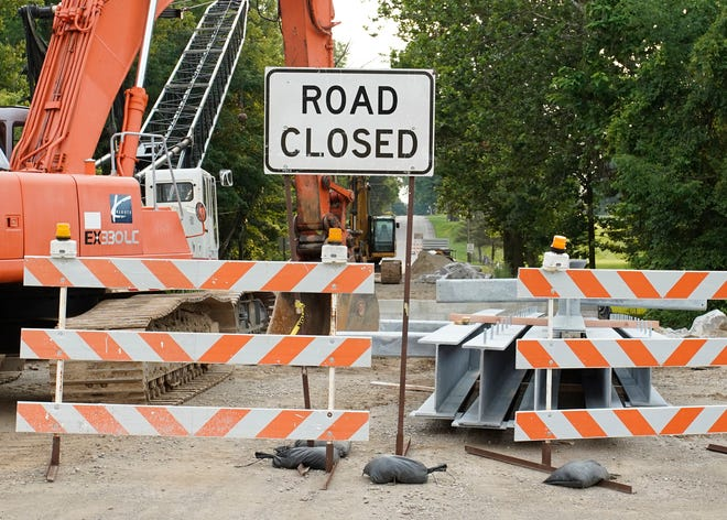 A road closed sign is up on Country Club Road outside the bridge near Tipton Highway.