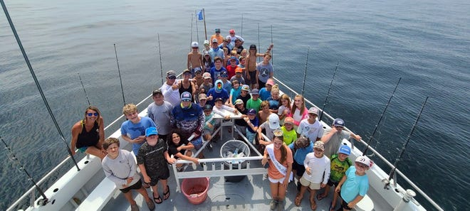 About 50 youth boarded the New Florida Girl's American Spirit on Wednesday for a morning of fishing.