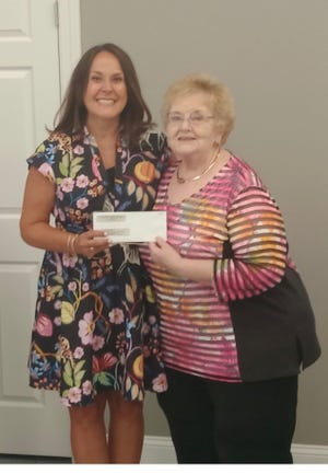 Brandi Burdette, executive director of Kid's Place in Lawrenceburg is presented with a donation by Sue Campbell, treasurer of Faith Fellowship Cumberland Presbyterian Church.