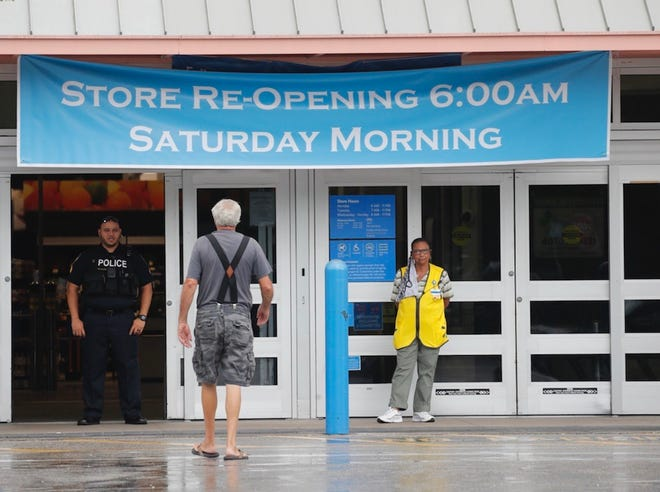 A man approaches the entrance of Walmart in DeLand on Thursday, July 29. The store closed at 2 p.m. for a deep cleaning. It's scheduled to reopen Saturday at 6 a.m.