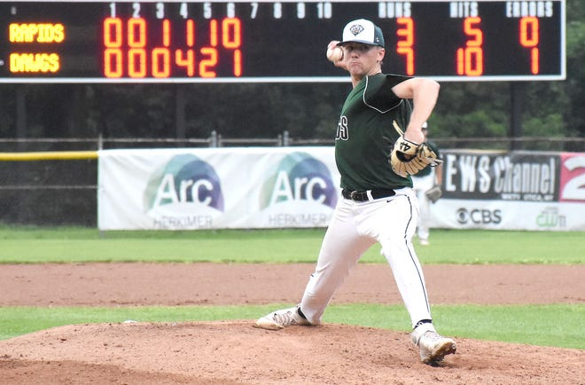Mohawk Valley DiamondDawg Troy Butler delivers a pitch during the first game of Tuesday's doubleheader against the Watertown Rapids at Veterans Memorial Park.