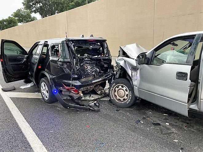 Florida Highway Patrol Lt. Sonja Chapman's unmarked patrol unit (left) is smashed on Interstate 295 near the Buckman Bridge after a Ford F-150 pickup truck rear-ended her on July 23.