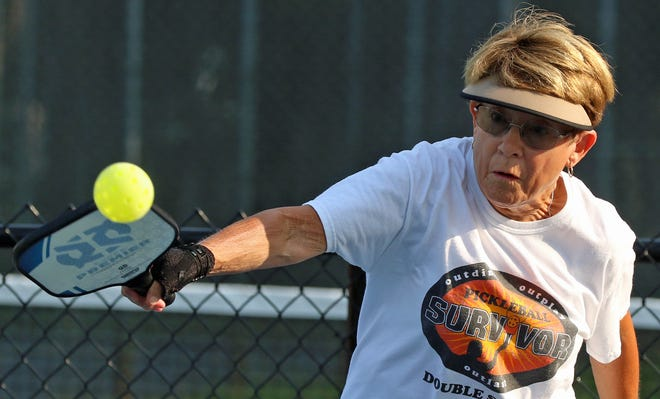 Beth Clary in action on the pickleball court on West Marion Street in Shelby early Thursday morning, July 29, 2021.