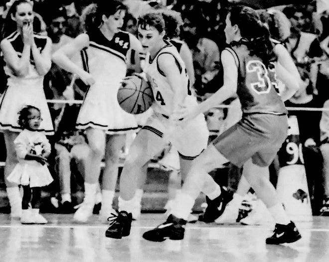 Sadie Ochs, left, runs the Garden City High School offense during a basketball game in 1993. Sadie (Ochs) Gied, Class of 1994,  is one of the Buffalo graduates to be inducted into the GCHS Hall of Fame in the 2021 class.