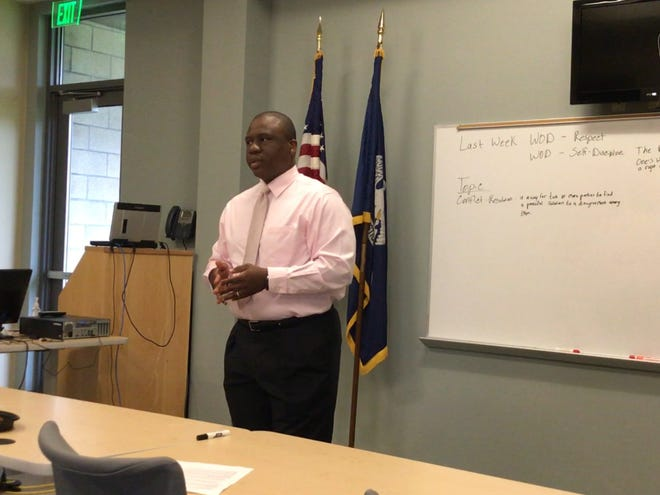 Local lawyer Travis Turner gives a presentation on conflict resolve to parish youths at a summer mentoring session.
