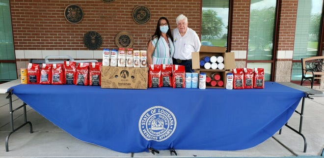 Delphin Russelburg presents donated coffee and supplies to Nevada Earp at the SE War Veterans Home in Reserve.