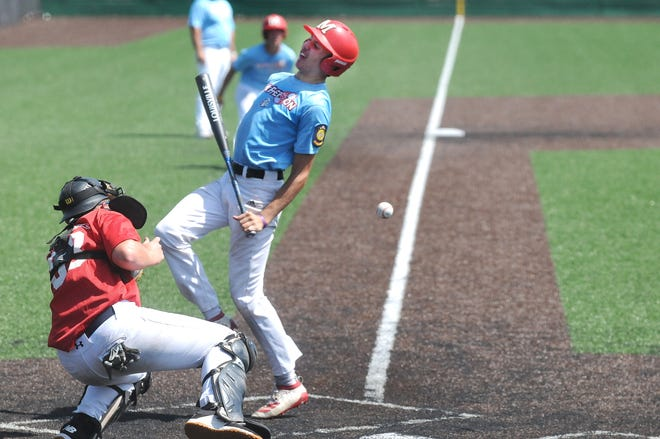 McPherson's Gavin Richardson is hit by a pitch in the fifth inning of Thursday morning's Kansas Junior American Legion state tournament game against the Salina Eagles at Dean Evans Stadium.