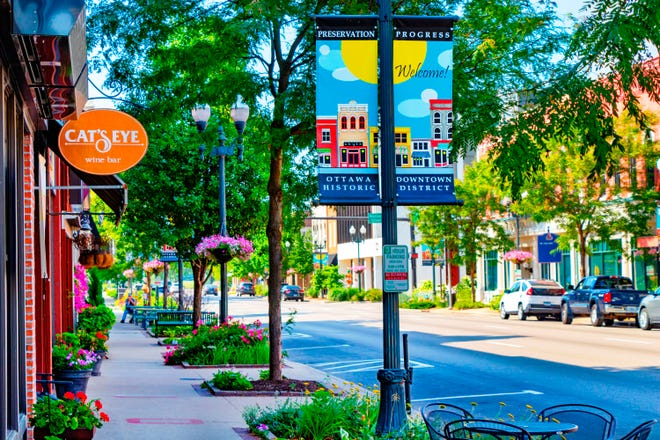 Businesses line a street in downtown Ottawa. Leaders in the LaSalle County seat of about 18,000 people decided a few years ago to focus on ecotourism.