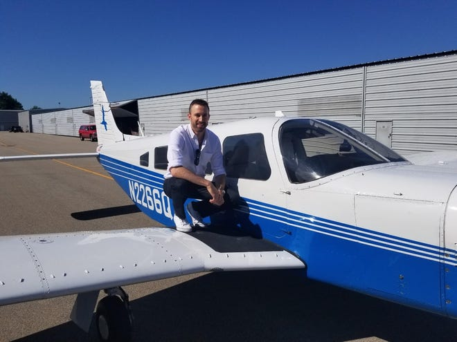 LifeLine Pilots volunteer Andy Zich of Peoria poses on a wing of his Piper Lance at Mt. Hawley Airport in Peoria in 2019.