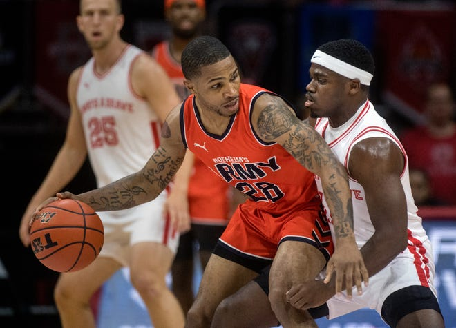 Darrell Brown Jr., right, of Always A Brave, defends against Keifer Sykes of Boeheim's Army during the third round of The Basketball Tournament on Wednesday, July 28, 2021 at Carver Arena. Brown and Sykes were both coached by current Bradley head coach Brian Wardle during their collegiate careers.