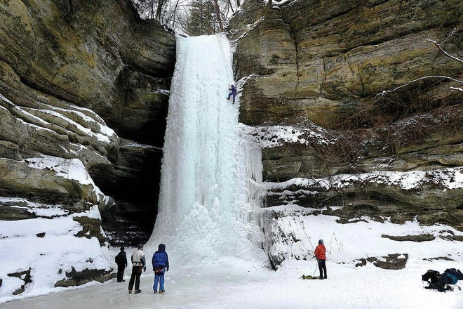Climbers scale an ice wall during winter at Starved Rock State Park near Utica. The Ottawa area of LaSalle County has focused in recent years on ecotourism, with good results.