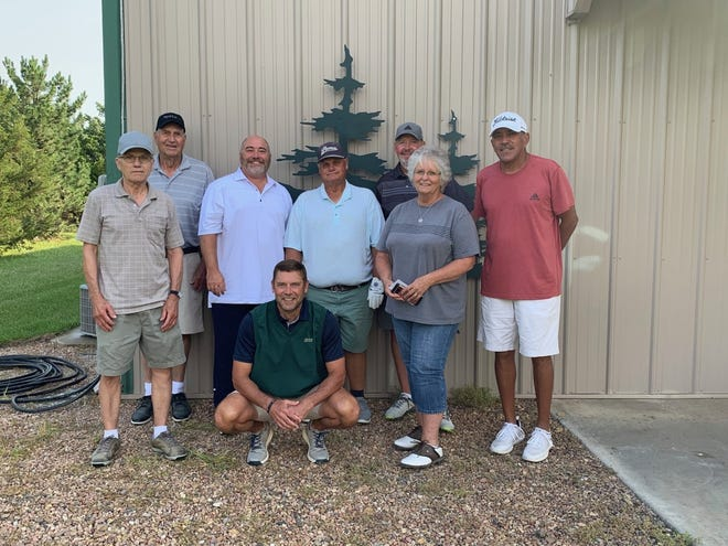 Winners of the annual Pine Edge putting contest and two-player, best-ball tournament recently held at the rural Goessel course. Kneeling is Gregg Dick, winner of the putting contest. Other winners include —Front Row (left to right): Leroy Koehn, Gavan Petersen, Bob Henson and Connie Glock. Back Row: Dale Dick, Bart Patterson and Anthony Jenkins.