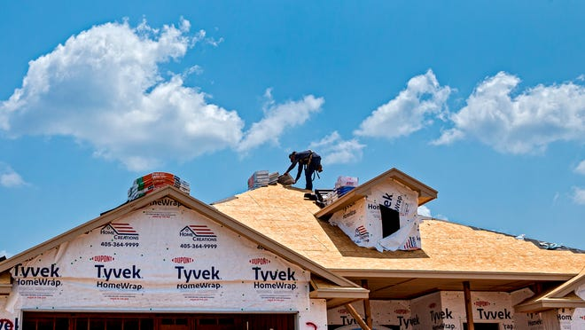A crew works on new home by Moore-based Home Creations at 2325 Norwood in the Bellatona addition in Norman.